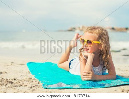 Little Girl Sunbathing On The Beach. Place For Text.