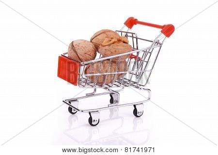 Walnuts In Miniature Shopping Cart Isolated On White Background