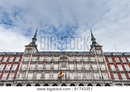 The Plaza Mayor was built during the Habsburg period and is the central plaza in the city surrounded by three-story residential buildings having 237 balconies facing this square in Madrid Spain. poster