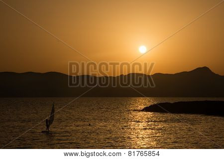 Windsurfer At Sunset