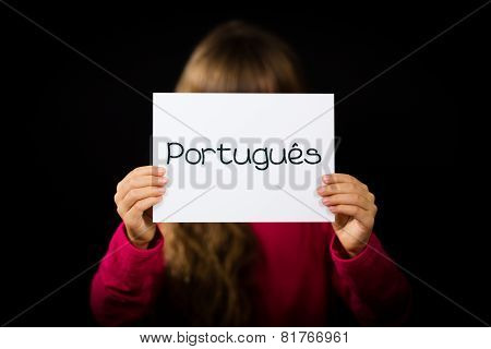 Child Holding Sign With Portuguese Word Portugues - Portuguese In English