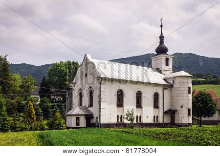 White Catholic Church Against The Rocks In Slovakia