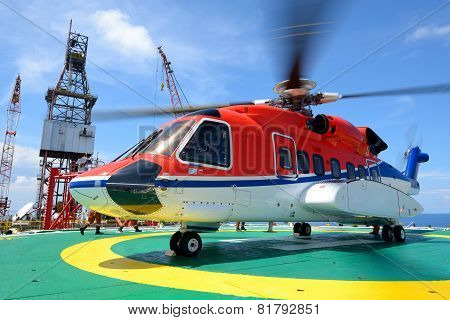 Helicopter Pick Up Passenger On The Offshore Oil Rig Platform