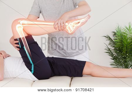 Digital composite of Highlighted bones of woman at physiotherapist poster