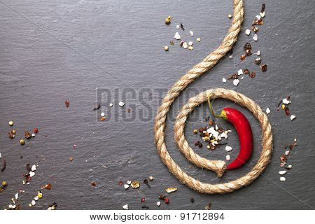 red chili pepper with a rope