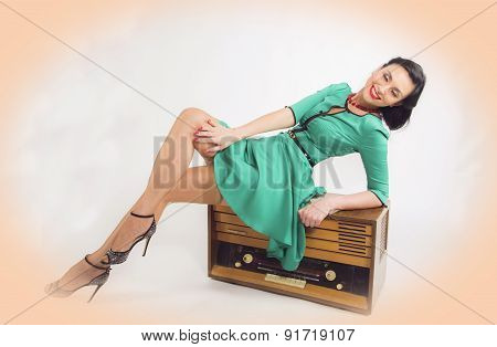 Young pin-up women with retro old redio