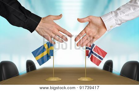 Sweden and Norway diplomats agreeing on a deal