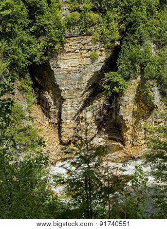 The vertical walls at Ausable Chasm gorge are made of Potsdam sandstone. The sandstone walls were dramatically carved during the last Ice Age (Pleistocene) about 15000 years ago. The wall section in the image is called the Elephant's Head. poster