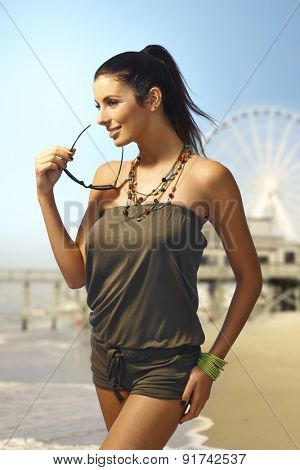 Sexy woman in beachwear on the beach at summertime.