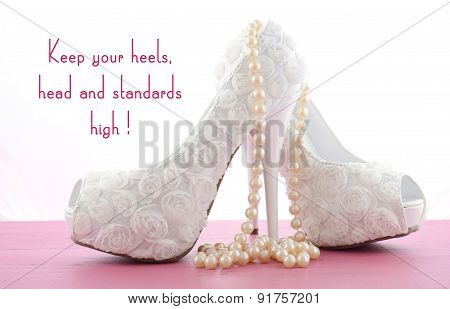 High Heel Shoe with Keep You Heels and Standards High quotation on pink wood table. poster