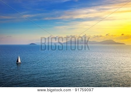 Elba Island Sunset View From Piombino An Sail Boat. Mediterranean Sea. Italy