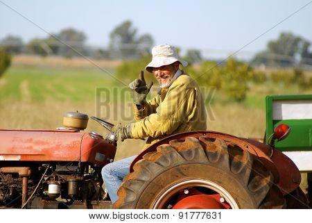 Farmer On Tractor 01