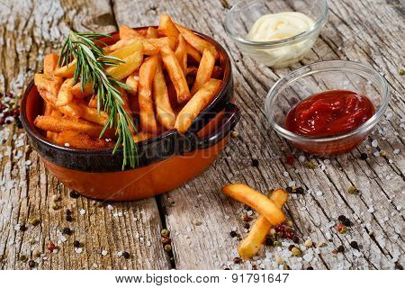 French Fries In A Bowl On A Rustic Wooden Floor