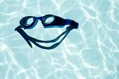 big smile - swimming glasses in a shape of happy face fun - showing that it is a great activity poster