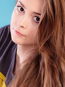 Beautiful female young woman teen girl with brown long healthy loose hair blue background poster
