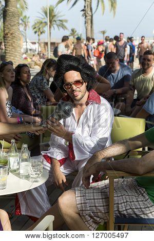 SPAIN, BARCELONA, JUNE, 27, 2015 - Costume party in the style of Elvis Presley on the Barceloneta beach in Barcelona, Catalonia, Spain.