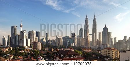 KUALA LUMPUR MARCH 13th 2016: Panoramic view of Kuala Lumpur skyline with Petronas Twin Towers and other corporate buildings on March 13th 2016 in Kuala Lumpur Malaysia