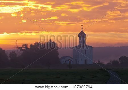Beautiful sunrise over Church of the Intercession of the Holy Virgin on Nerl River Bogolyubovo Russia