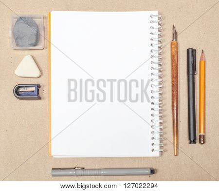 Blank Sketchbook Page With Pen And Eraser On Craft Papper