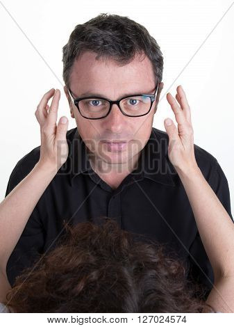 Top View Of  Optician Offering Glasses Frames To Male