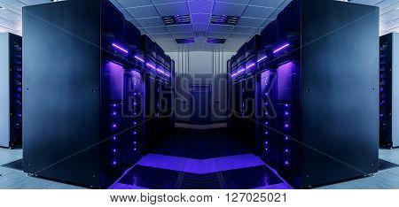symmetrical data center room with futuristic beams and rows equipment