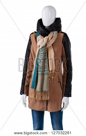 Long brown jacket with scarf. Mannequin wearing jacket with inserts. Leather inserts on sleeves. Woman's trendy outerwear from magazine.