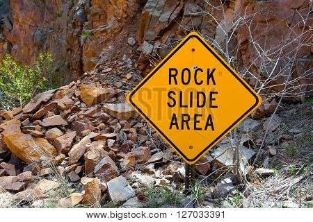 Rock Slide Area Sign with Fallen Rocks
