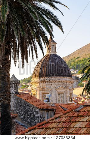 Assumption of Virgin Mary cathedral oblong dome rising over the tiled rooftops at Dubrovnik