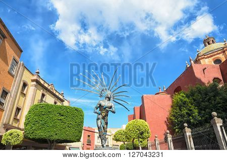 QUERETARO MEXICO 10 MARCH 2016: Metal statue of dancing Indian man in Queretaro's downtown.