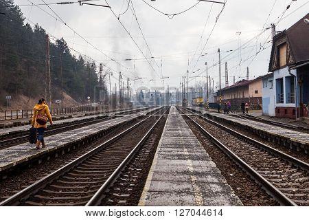 RUZOMBEROK, SLOVAKIA - FEBRUARY 27, 2015: Train is arriving into the railway station of Ruzomberok Slovakia on February 27, 2015. The railway station of Ruzomberok was opened on December 8, 1871.