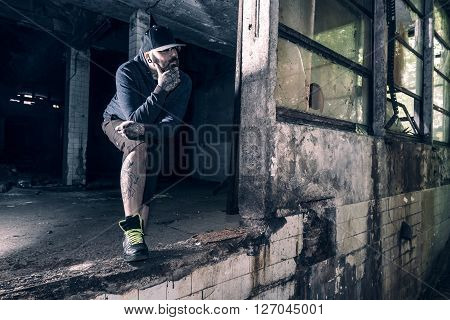 Portrait of urban man in old building, selective focus ** Note: Visible grain at 100%, best at smaller sizes