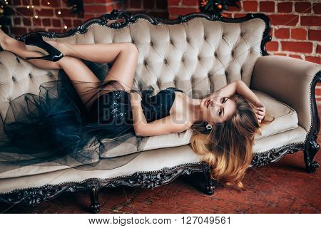 Portrait of beautiful young woman in fashion clothes