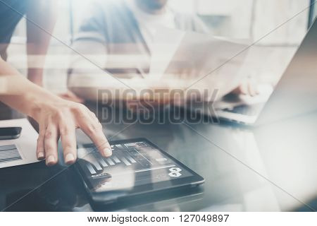 Business situation.Meeting of investment managers.Photo female showing document.Man holding report, using laptop.Working process modern office, discussion startup. Horizontal. Film and bokeh