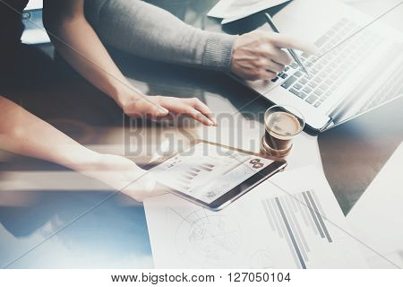 Finance investment work process.Photo woman showing business report modern tablet, diagram screen.Banker man holding pen for signs document, discussion startup idea.Horizontal.Film and bokeh