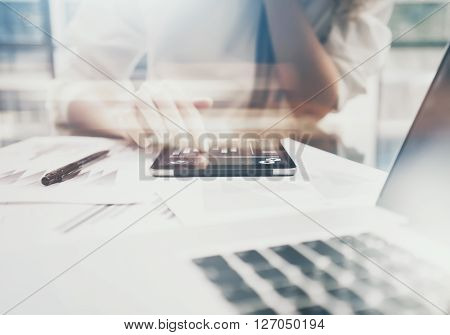 Investment manager working process.Photo business woman showing reports modern tablet screen.Statistics graphics screen.Banker ready for signs documents, new startup.Horizontal, bokeh and film
