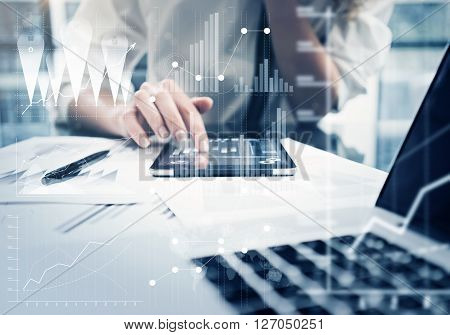 Photo woman hand touching modern tablet.Investment manager working new private banking project office.Using electronic device. Graphic icons, worldwide stock exchanges interface on screen.