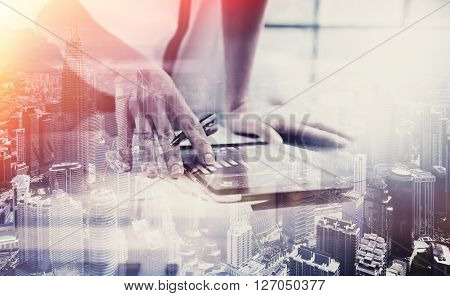 Photo female hand touching modern tablet.Investment manager working new private banking project office.Using electronic device. Graphic icons, worldwide stock exchanges interface on screen.  Horizontal