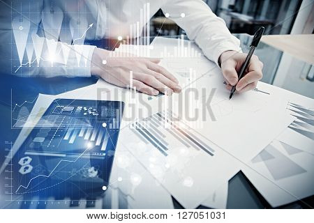 Businessman working process.Concept photo trader work market report modern tablet.Using electronic device.Graphic icons, stock exchange reports screen interfaces.