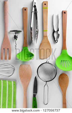 Set of stainless and wooden utensils, isolated on white poster