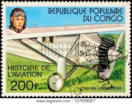 MOSCOW RUSSIA - APRIL 22 2016: A stamp printed in Congo shows American pilot Charles Lindbergh and his plane Spirit Of St.Louis (1927) series