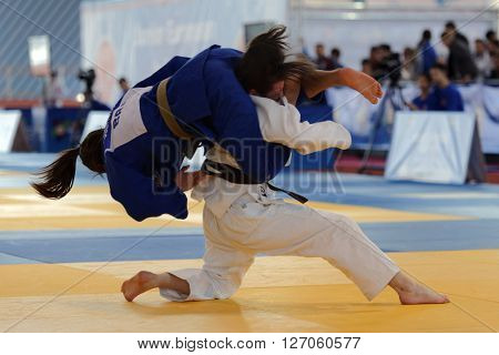 ST. PETERSBURG, RUSSIA - APRIL 16, 2016: Match Gabriela Clemente of Brazil (blue) vs Viktoriia Soldatenkova of Russia during the Junior European Judo Cup. 346 athletes participated in the competition