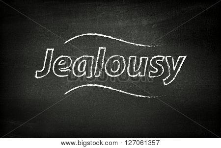 Jealousy written on blackboard