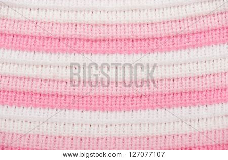 knitted wool macro photo closeup pink and white color as background