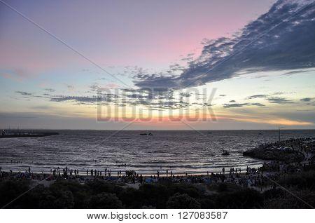 FREMANTLE,WA,AUSTRALIA: JANUARY 26,2016: Colourful sunset skies at Bather's beach with people on Australia Day in Fremantle, Western Australia.