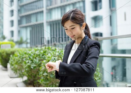Asian Businesswoman use of smart watch