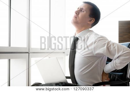 Young Business Man Having Back Pain