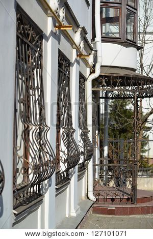 Metal wrought-iron bars on the windows of an apartment house