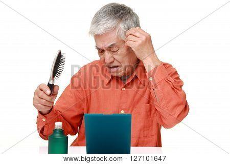 senior Japanese man warries about losing hair poster