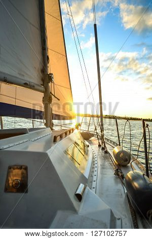 white deck of a yacht at sunset dawn with filter