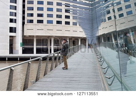 Melbourne Australia- May 26 2012. Male stops to take a photograph from walkway across the Yarra River Melbourne Victoria Australia